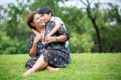 Happy Asian family ,mother with her son at park — Stock Photo