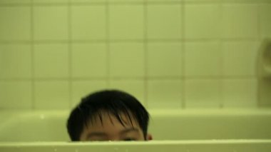 Happy asian boy take a bath in bathroom at home . — Stock Video