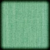 Background texture of green fabric closeup with vignette — Foto Stock