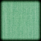 Background texture of green fabric closeup with vignette — Стоковое фото