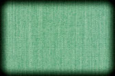 Background texture of green fabric closeup with vignette — Stock Photo