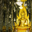 Golden Buddha statue at Cathedral glass, Temple in Uthai Thani , — Stock Photo #55493075