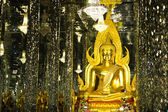 Golden Buddha statue at Cathedral glass, Temple in Uthai Thani , — Stockfoto