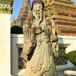 Ancient statue in the complex of Wat Pho, the Temple of the Recl — Stock Photo #58930733