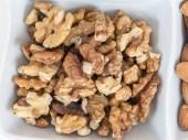 Walnuts in a white dish — Stok fotoğraf