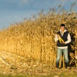 Farmer in corn field — Stock Photo #55957089