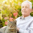 Old man with cat — Stock Photo #56176219