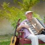 Senior music player — Stock Photo #58788169