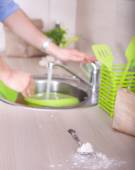 Washing dishes after kitchen work — Stock Photo