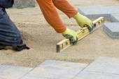 Paver leveling sand — Stock Photo