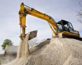 Excavator loading truck — Stock Photo