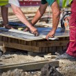 Worker preparing plank for cutting — Stock Photo #75358971