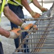 Workers fixing armature — Stock Photo #75381505