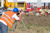 Worker with theodolite — Stock Photo