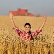 Smiling girl in wheat field — Stock Photo #78461658