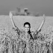 Smiling girl in wheat field — Stock Photo #79455162