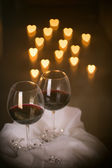 Heart lights and wine glasses — Stock Photo