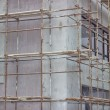 Building covered with scaffolding at construction site 2 — Stock Photo #53471839