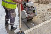 Cutting asphalt road with diamond saw blade 2 — Stock Photo