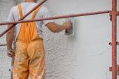 Plasterer applying a finish coating to a wall 3 — Stock Photo
