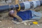 Welder welding underground steel pipe lying on ground 4 — Foto de Stock