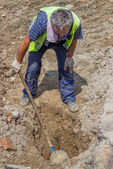 Worker looking for lost water pipe — Stock Photo