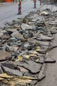 Heap of broken asphalt on road surface — Stock Photo