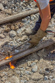 Industrial worker cutting a old tram tracks with an oxy-acetylen — Photo