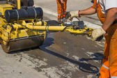 Workers installing asphalt speed bump — Stock Photo