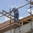 Construction worker on top of a new building — Stock Photo #56121575