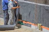 Workers installing wall insulation — Stock Photo