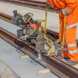 Tramway track construction worker with rail grinding machine 2 — Stock Photo #58404975