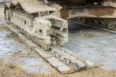 Excavator with broken caterpillar — Stock Photo