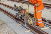 Tramway track construction worker with rail grinding machine 2 — Stock Photo