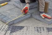 Paver measuring irregular space for laying concrete brick 2 — Stockfoto