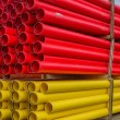 Stacks of various colored pvc water pipes — Stock Photo #61609901