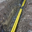 Yellow plastic line in the trench — Stock Photo #61614449