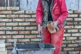 Bricklaying mortar spreading — Stock Photo