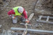 Cutting wooden beam for formwork — Stock Photo