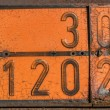 Old and rusty orange plate with hazard identification number — Stock Photo #62156227