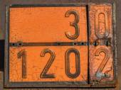 Old and rusty orange plate with hazard identification number — Stock Photo