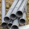 Stacks of pvc pipes at construction site — Stock Photo #64122611