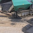 First layer of asphalt 2 — Stock Photo #64122983