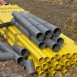 Stacks of colored pvc pipes — Stock Photo #64123277