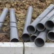 Stacks of pvc pipes at construction site 2 — Stock Photo #64123289