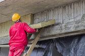 Man installing external wall insulation 2 — Stock Photo
