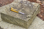 Mineral rockwool panel with a craft knive — Stock Photo
