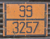 Orange plate with hazard identification number on bitumen tank — Stock Photo