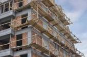 Wooden scaffolding on a building — Stock Photo