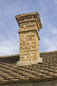 Old brick chimney with old tiles roof 2 — Stock Photo